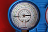A close-up view of the low (blue) pressure indication at 18 psi. At idle, it should indicate about 30 to 35 psi.<br /> <br /> The system needed further charging with R134a.