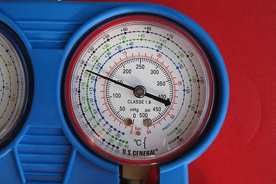 A close-up view of the high (red) pressure indication at 150 psi.  The system needed further charging with R134a.