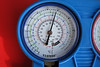 Static gauge indication with the engine off.<br /> <br /> A close-up view of the low (blue) pressure indication at 65 psi, with the A/C compressor not running. At an ambient temperature of 25º C, the gauge should have indicated about 83 psi.