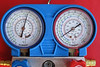 Static gauge indications with the engine off.<br /> <br /> Both low (blue) and high (red) pressure indications are the same at 65 psi, as they should be with the A/C compressor not running. At an ambient temperature of 25º C, the gauges should have indicated about 83 psi.<br /> <br /> Although the A/C system was cool the last time it was used a few months ago, the system needed a bit of topping up.