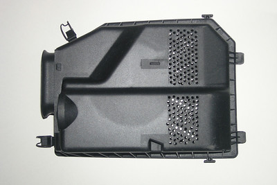 """My OEM airbox cover with holes randomly drilled by someone else.  A piece of 1/8"""" square graph paper taped to the airbox cover and then center-punched would have aided in a more uniform layout with the end result being a much nicer job."""
