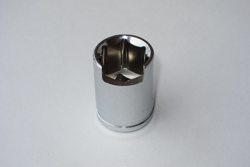 "A 3/8"" square drive, 15 mm socket was modified by cutting, grinding and filing a channel to fit the 15 mm, 0 degree offset, ratcheting box end wrench that will be attached to the socket."