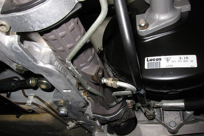 """With one of the power steering lines removed, the power steering fluid drained. It drains slowly, so you might want to take a break.  Note: these hydraulic fittings are not like those used in brake systems. There is an O-ring at the end of each power steering line that should be replaced. Unfortunately, the O-rings are not available from Porsche; at least they are not shown in the Porsche parts catalog. I reused the O-rings, but I was extra careful removing them to inspect them for damage. They were slightly stiff, but a very long way from being brittle.  The original O-rings measured: ID: 5.60 mm, 0.2205"""" OD: 9.13 mm, 0.3595"""" CS: 2.00 mm, 0.0790"""""""