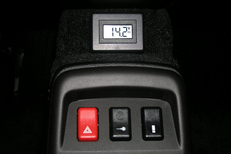 "The voltmeter was wired directly to the battery for an always-on state while indicating the actual battery voltage. The voltmeter draws less than 2 mA and even if a battery maintainer is not used, it would deplete the battery by less than 1.5 Ah per month. <br /> <br /> Wiring of the voltmeter to the battery couldn't be easier. The following photos show how the voltmeter cable was routed.<br /> <br /> The voltmeter cable used is Belden 8451, 2-conductor (red-black), 22 gauge (7 x 30 gauge). The outer insulation is black with a nominal diameter of 0.138"".<br /> <br /> The voltmeter cable coming out the back of the voltmeter was routed between the carpeting and lower edge of the ashtray.<br /> <br /> The how-to to fabricate the voltmeter can be found on my Technical Stuff page in the Motorcycles section of my SmugMug site (link below).<br /> <br /> <br /> <a href=""http://edelweiss.smugmug.com/Motorcycles/Technical-Stuff/Surface-Mount-Datel-LCD/7261107_7G2RBB#466706719_xovAp"">http://edelweiss.smugmug.com/Motorcycles/Technical-Stuff/Surface-Mount-Datel-LCD/7261107_7G2RBB#466706719_xovAp</a>"