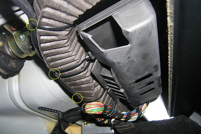 The voltmeter cable was placed along the front side of a wiring harness that runs across the driver's side above the pedals. Four existing tie wraps (yellow circles) that had ample room for the voltmeter cable were used by feeding the voltmeter cable though.