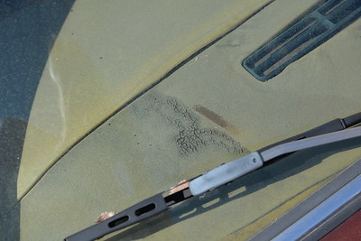 Dash top leather has deteriorated.