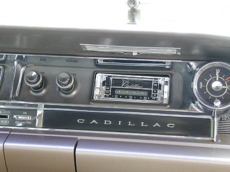 While the water pump was being resolved, I swapped the radio out for a more modern one. This model is produced by Custom Autosound and is designed to fit the dash without any cutting or modifications. It could fit better.. July 2004.