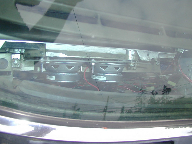 """The car originally came with one 4x10 speaker in the dash. My solution was to mount 2 3.5"""" speakers to a piece of plexi-glass and then mount it to the original speaker location. July 2004."""