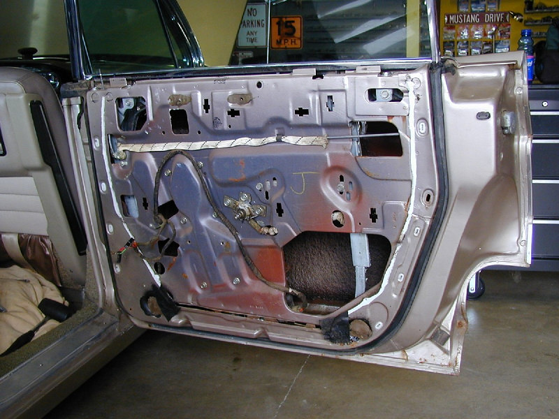 While replacing some weatherstripping, I re-lubricated some of the gearing for the power windows. Rear passenger door is in great shape. September 2005.