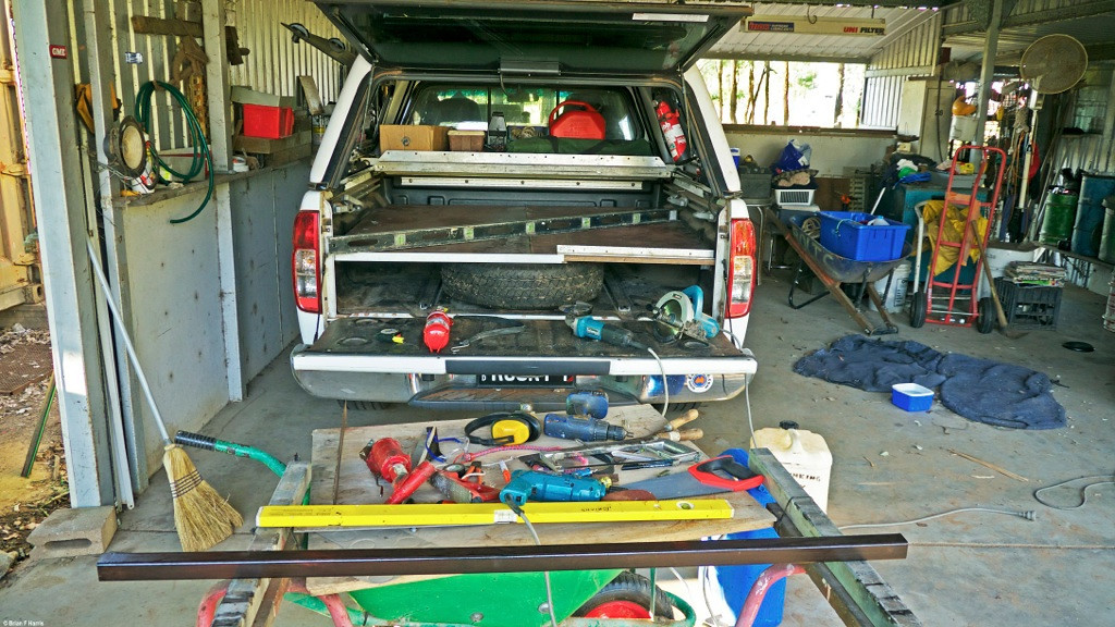 "DIY deck in my Nissan Navara D40 dual cab. As I had all the materials to make it, was no use me paying some $1200 plus (incl freight) to buy a factory setup. A 4x4 mate was going to dump the two big sheets of structural 'Form Ply' so he was good enough to drive the 32k out to our place to see if I wanted it. "" Yes please "" All the steel and aluminium was re-cycled at least once. Sure, I had to buy a factory fridge slide (could make one if I really wanted to) but if I had the factory deck, still would have to add the fridge slide to the bill. Slide is high quality steel and sealed ball bearings and glides just so smoothly, even when fridge is loaded. Note the ripper shelf I made way back behind the cabin. Holds heaps. Easy port window access."