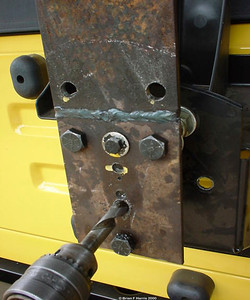 Larger tyre was not sitting well on stock spare wheel carrier so made up this raising plate out of some plate steel. Worked fine untill a few years later I got the ripper ARB swing away tire carrier with a positive position lock devise.