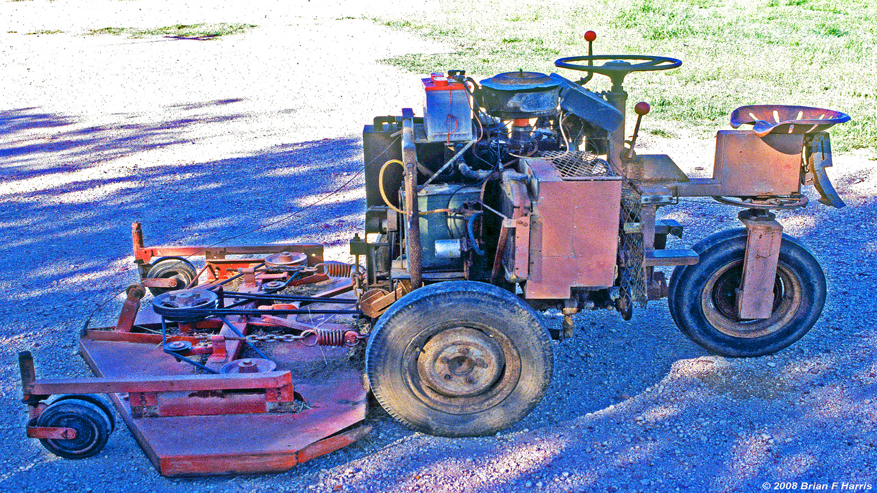 The mowing machine I designed and built way back when we lived on our five acre block just south of Brisbane in Queensland, I went to night college for 22 nights, one night a week to learn about fluid power (hydraulic etc) to make the mower. A neighbour gave me a Mazda 4cyl engine, gearbox, wheels etc out of a fishing car that had a rusted body.The engine drives the Charlyn hydraulic pump which pushes the fluid through the forward, reverse, neutral spool valve control and then into the hydraulic motor hooked directly to the Mazda diff.I built the three spindle mowing deck and made the bullet proof spindle tubes out of heavy scaffolding type pipe lathed out for one bearing at the top and two at the bottom working shock end. Worked fine.