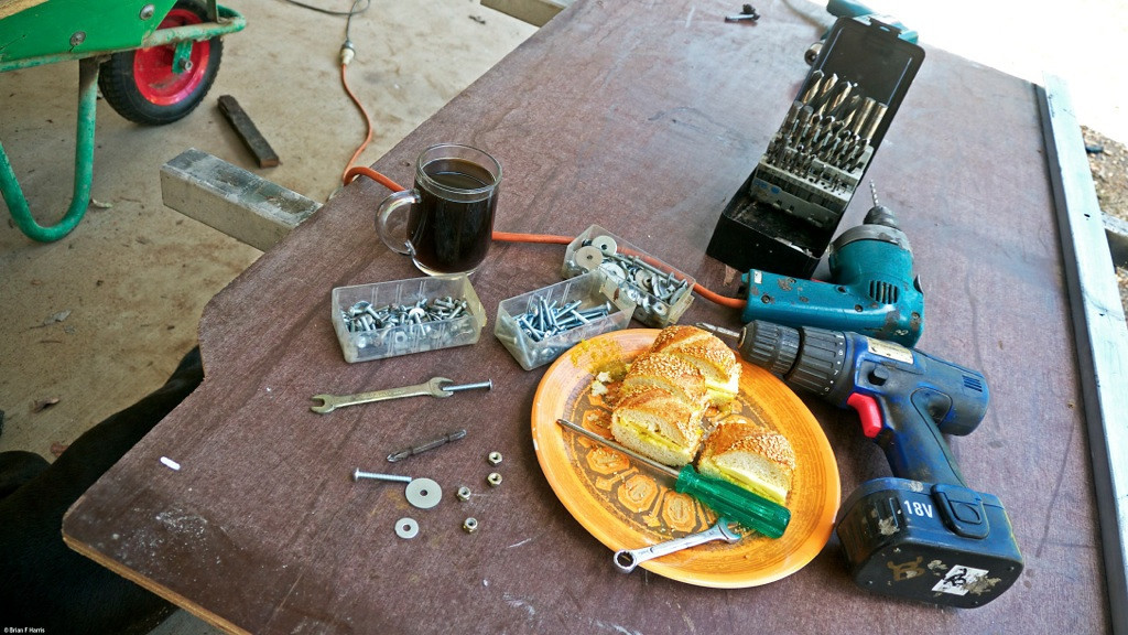 Workshop work / play is, for me, a kind of entertainment as it keeps us out of the house (prison) and away from the TV (vege) so if we are going to slave away over a hot work bench, we should make sure we have enough good fuel to last the distance. I just l o v e those bread sticks so here is my smoko (our dog Spanner gets some too). I need the coffee with the vitamin C (caffeine) to help power me through a long and arduous day, apart from the fact that I like it anyway (one sugar but no milk please). This sheet of structural form ply will soon be part of my deck. Note cut outs.