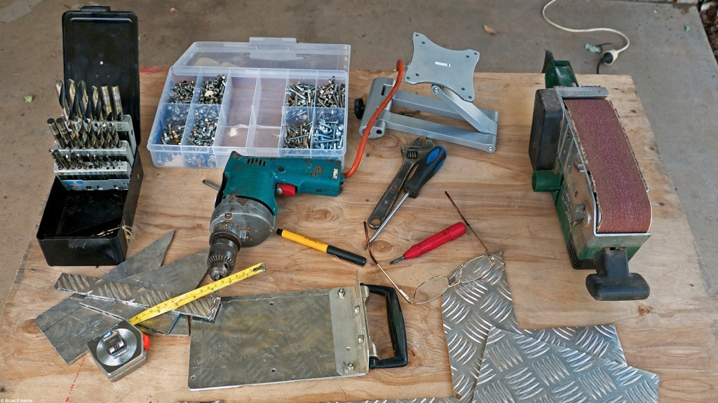 Tools and bits for yet another DIY project. Making up a lift handle for my new portable LCD TV. Will also be able to hang it up on chains over at my 'Movie Shack'. Lucky. Had some aluminium checker plate left over from one of my Jeep & Rocsta false floor projects. Nice gear to work with.