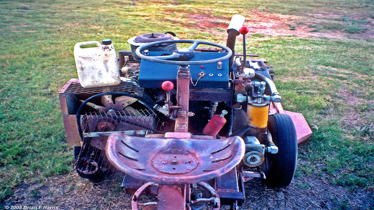 Motor and non hydraulic comonents from a rusted out, but mechanacily sound Mazda 800cc van donated by our neighbour Pat Paton. Brian went to Yeronga Tech College for 22 weekly one night lessons on 'Fluid Power to get it right. Move hydraulic spool valve forward, centre for neutral and pull back for reverse. Simple. Anyone can drive and cut six foot wide & around trees.