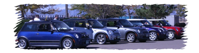 Five MINIs, ready to hit the track! Brad is driving the Indi Blue, Jonathan the silver, Jeff in the dark silver, Rick is in the purple and Lloyd is driving the red MINI.
