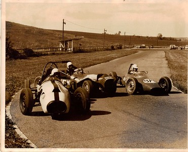 "Photo from Ron Mann, Pennsylvania Hillclimb Association Historian.  Photo taken at an autocross track near Bernville, Pa.- Christmas Village gocart track- now defunct. The other two cars are Randy Ravel in the DKW-Mitter Formula Junior, and Denny Gawrys in ""The Blue Goof""- a Saab powered Spitfire with custom, albeit crude bodywork. Carrol Shelby once drove the Mitter, and called it the most unsafe car he'd ever driven."