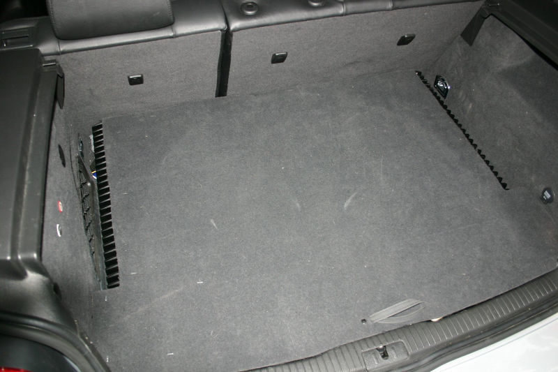 "This is the stock hatch floor carpet, modified as follows:  1) cutouts along either side allow the amp vent fins to get air 2) 3/8"" plywood glued to underside makes it stiff enough to support cargo and the sub enclosure 3) bracing underneath the plywood keeps this cover up off the amps"