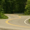 318 curves in 11 miles. With huge elevation changes.