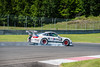 Lionel Meunier's 2010 Porsche GT3 Cup braking heavily into turn fourteen. (Photographer: Jon Jeffress)