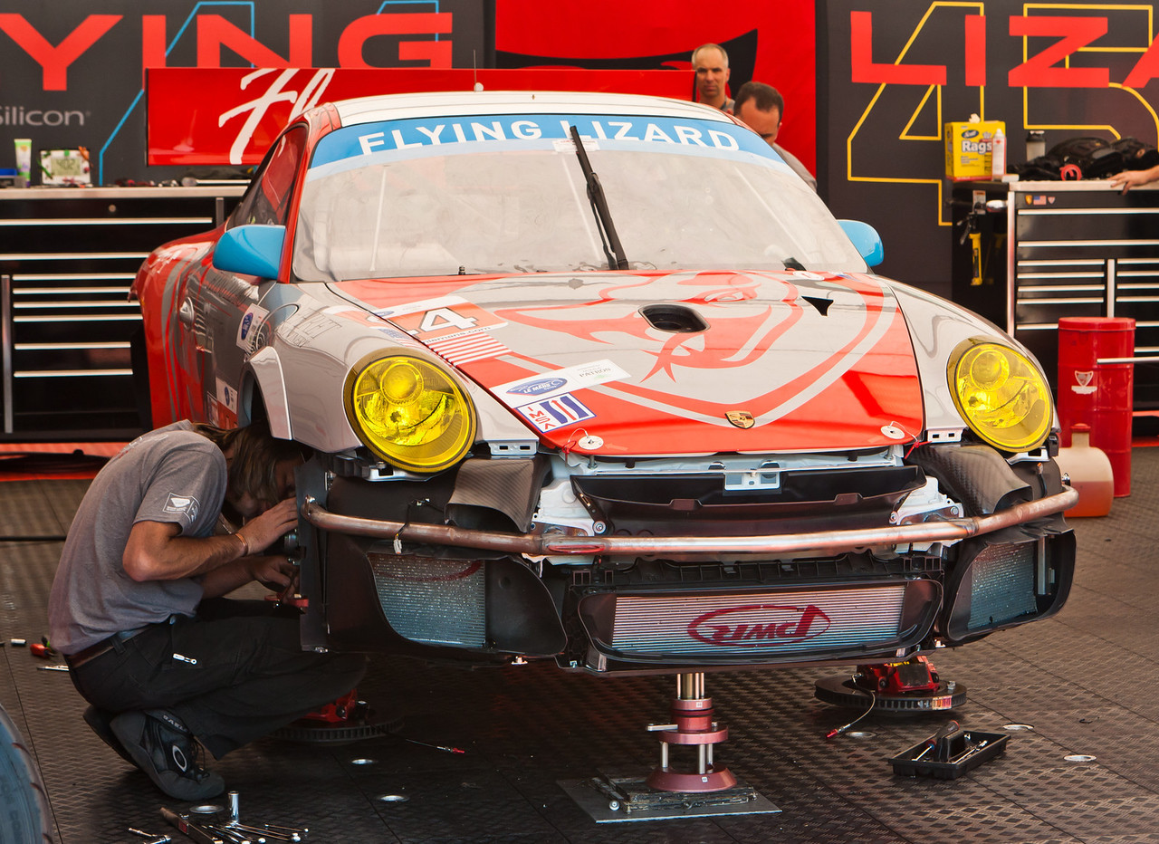 Pre-race brake and suspension setup in Flying Lizards paddock on GT3 Cup Car