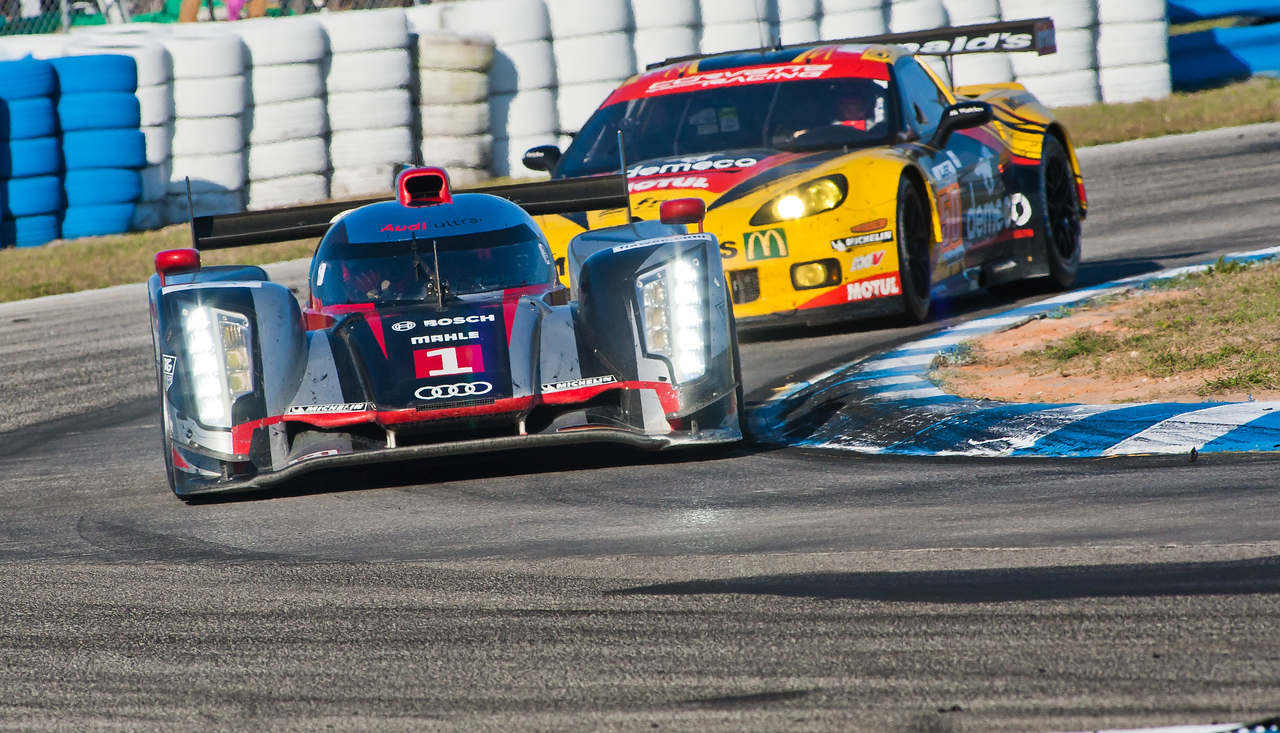Audi Sport Team Joest #1 leads Labre Competition C6-ZR1 in turn 5