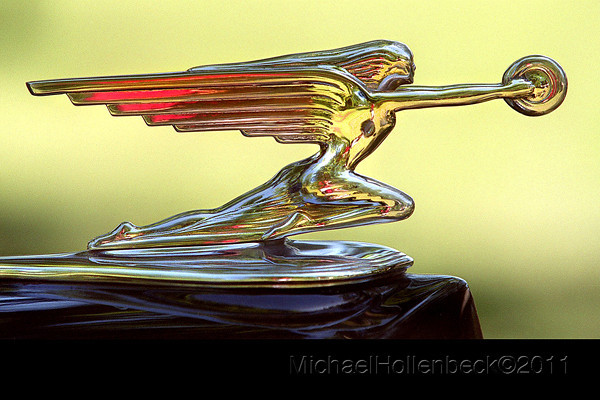 This hood ornament is on a 1937 Henny-Packard Hearse on display at the St. Charles 7th annual car show.<br /> Michael Hollenbeck