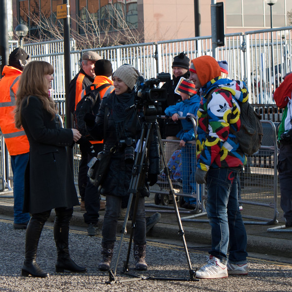 Our guess was a German film crew, based on the guys coat.