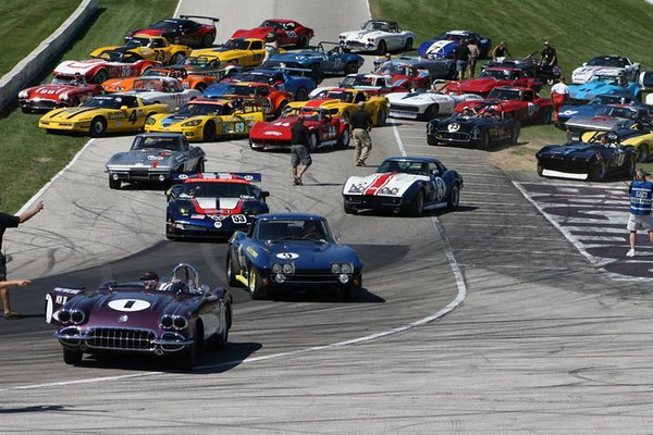 Lance Miller in PPE leads away  from Corvette Race Car group photo