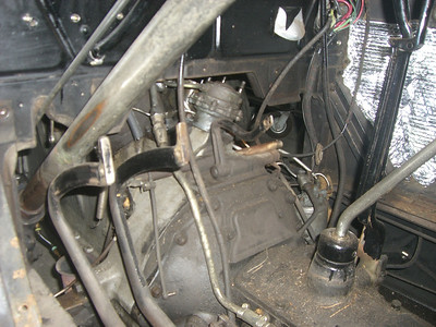 another view of vacuum pump on engine, before restoration