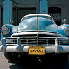 Frontal View of Old Blue American Style Car at Old Havana, Cuba. Car registration plate identity replaced with 'Havana Cuba'.