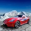 Side view of a Nissan 350z on sheet ice with breaks on the ice and 'on the edge' sticker on side of car in an icey environment on a clear day with blue sky.