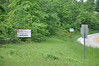 """The sign reads, """"Booger Hollow, Trading Post, Area Information (13 miles up the road)."""" Hwy 123."""