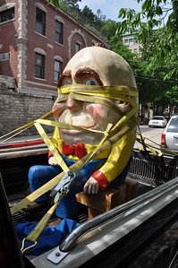 Looked like Humpty Dumpty (with a small stand of hair) sitting in back of a truck in Eureka Springs, AR.