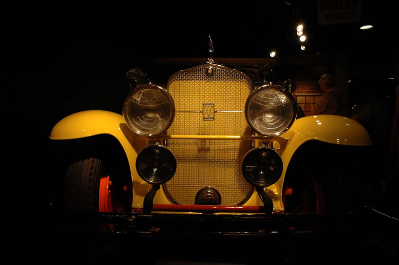 From the Timeline Gallery. This is a 1928 Cadillac Sport Phaeton Coupe 341. The color is authentic.