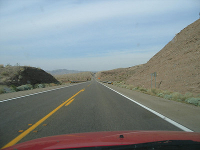 Approaching Hoover Dam, check out the nice view of the road ahead as it cuts through the undulating hills.
