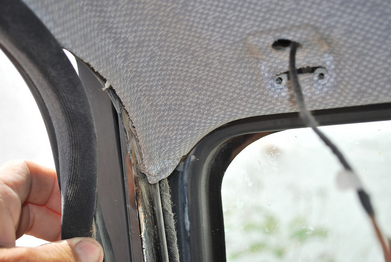 The door seal holds some of the interior pieces together - pull it carefully down