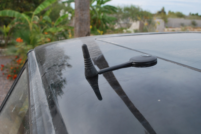 The cable protection is part of the accessory kit for the antenna - I pulled the strips and exposed the glue, then pressed it in place. Then I pushed the cell antenna cover back on. It snaps into place without a hitch. Looks pretty clean (not the car - I rarely wash my car).