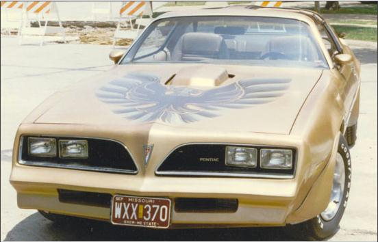 This was my second car.  It's a '78 Pontiac Trans Am.  I'm pretty sure it was a Y88 gold special eagle edition.  Had I known what that meant at the time, I might still have the car today.  It was a 400 (not the junk Olds 403) 4-speed with t-tops, and the motor had some performance parts when I bought the car.  It was a trailer park magnet, but I didn't care.  Ever since the first time I saw the movie Smoky and the Bandit, when I was maybe 7 years old, I knew I had to have a '77 or '78 Trans Am.  I sold it when I went to college.  I couldn't afford to put gas in the tank, much less paint it black or keep replacing the clutch and tires every time I burned them up.