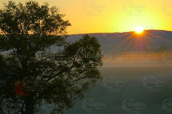 Sunrise and early morning fog, so many photographers!