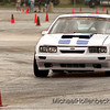 Curtis McGill driving his Mustang through the course of cones Sunday afternoon at the GM Powertrain Bay City parking lot.