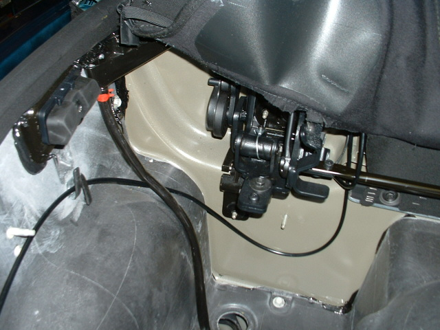 Driver's side convertible top hinge