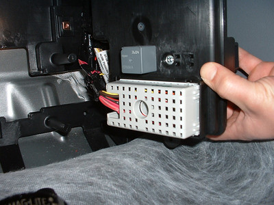 Backside of fuse/relay panel and BCM, which resides in the passenger's footwell against the firewall.