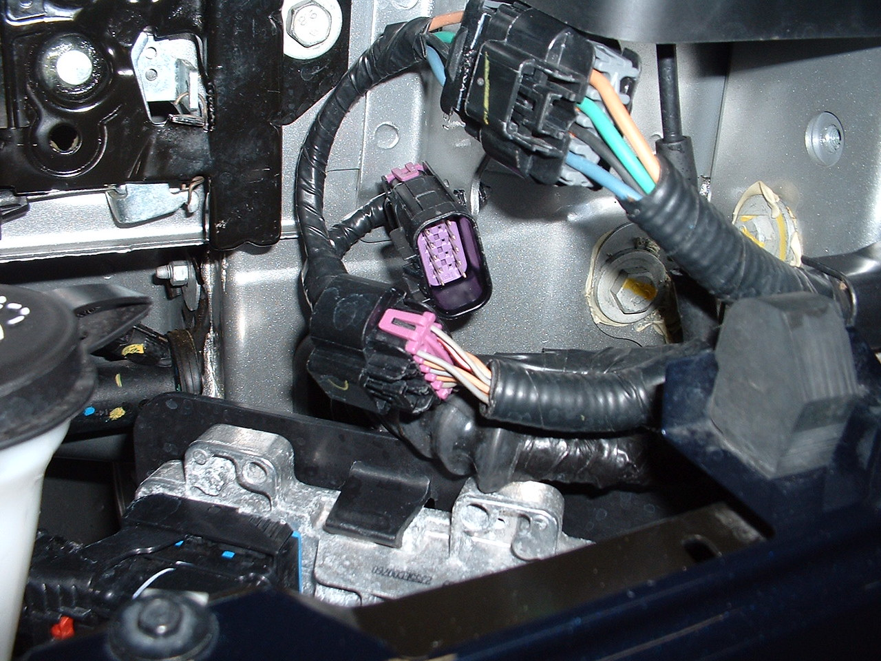Driver's side plug for power mirror wires, door lock actuator wires, dome light switch wires, and speaker wires.