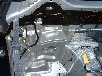 The upper void houses part of the factory subwoofer enclosure as well (the subwoofer was included in the Monsoon package only)