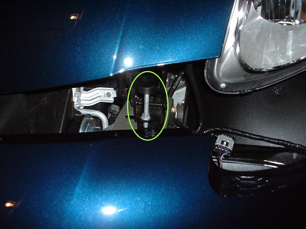 Front left hood height adjuster