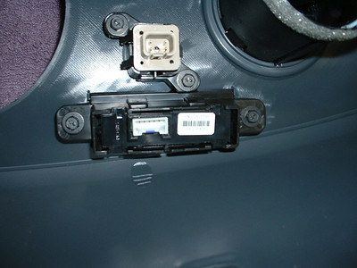 Backside of passenger airbag status light unit and 4-way flasher switch.