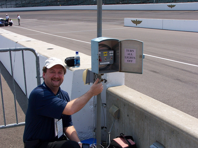 Tom Templin with his hands almost on the Green Light at the Indianapolis Motor Speedway.