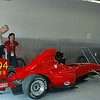A. Cheung driver and owner in red top.