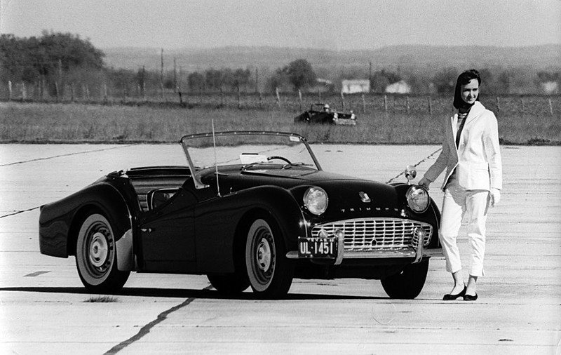 Photos from a sports car race in Texas, 1960. Photos made by Dale V. Monaghen with a Nikon F camera and 400mm lens. The black TR3 is owned by Dale, but not raced. Maryann stands by the TR3.(Race #1).